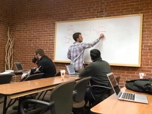 teacher explaining code